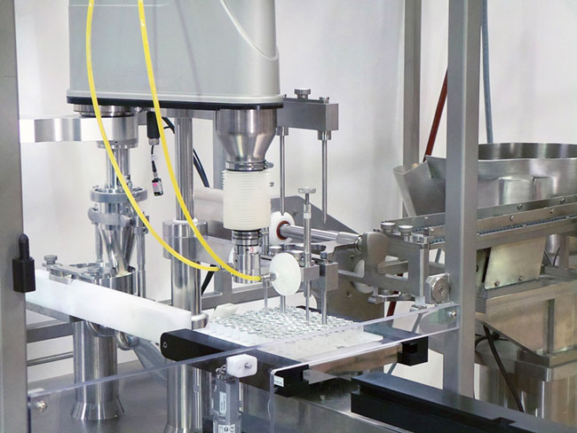 Nested Prefillable Syringe, Vial & Cartridge Filling and Stoppering Machine    	Output up to 120 cpm (7,200 cph) 	Manual or automatic loading system 	Versatile design to handle most nested components 	Compact footprint and quick set-up 	Integrated robotic handling