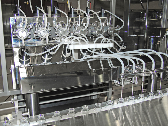 "High Speed Liquid Filling and Stoppering Machine    	Continuous motion with an output up to 360 cpm (21,600 cph) 	Container sizes up to 500ml 	Walking beam with bottom-up fill 	""V"" shaped tooling blocks to accommodate range of vials without change parts 	Ideal for large batch and commercial production"